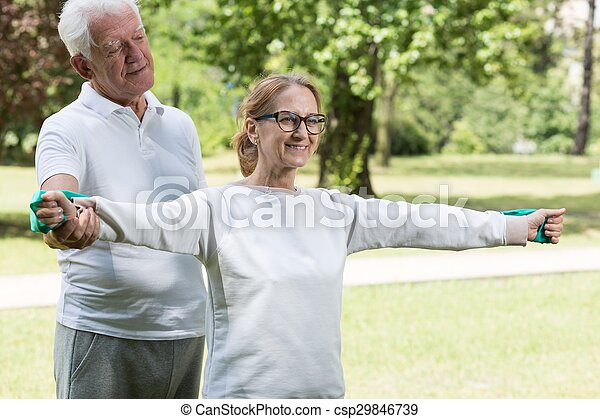 Athletic mature pair exercising together