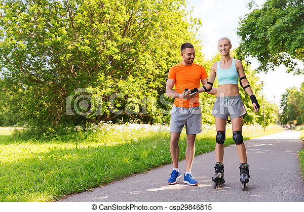 happy couple with roller skates riding outdoors
