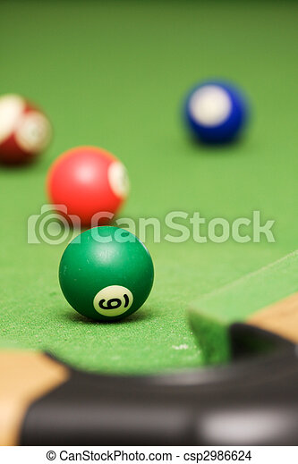 Pool balls on a green pool table - csp2986624