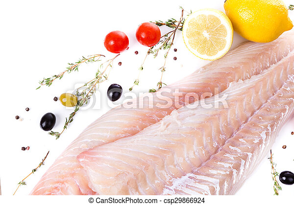 uncooked raw fillet of cod with serving spices