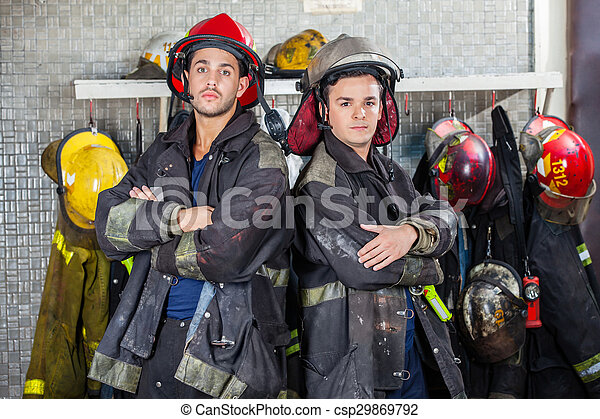 Confident Firemen Standing Arms Crossed
