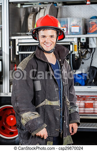 Happy Fireman Standing Against Truck