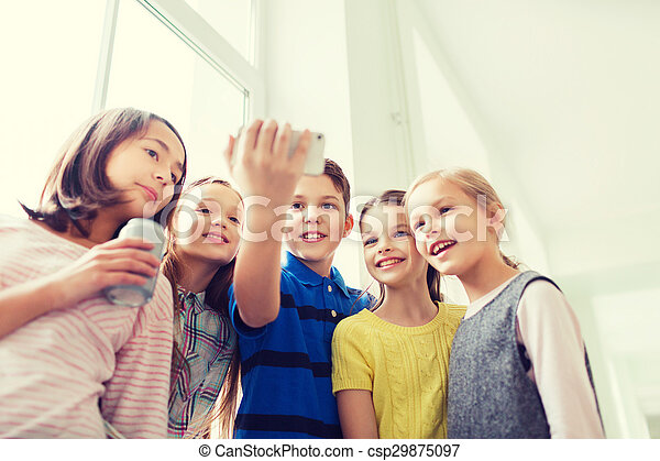 group of school kids with smartphone and soda cans