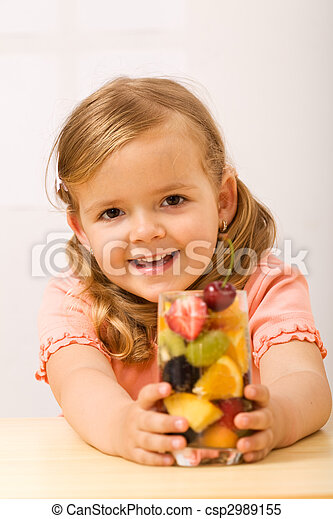 Happy little girl with fruity refreshment - csp2989155