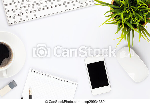 Office desk table with computer, supplies, flower and coffee cup