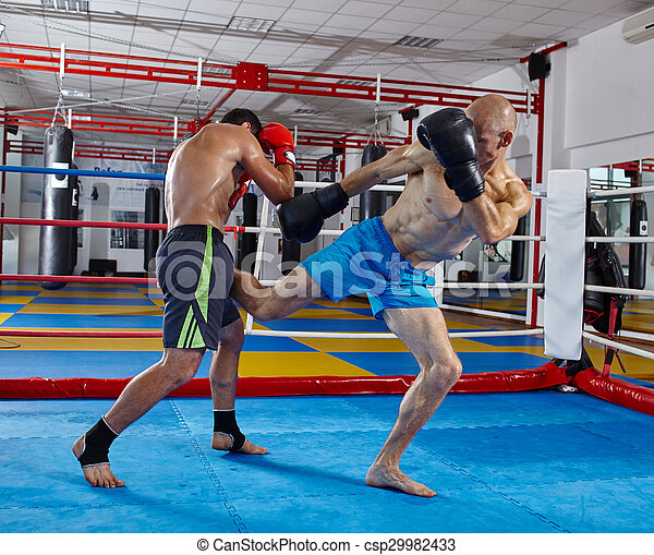 Kickbox fighters sparring in the ring