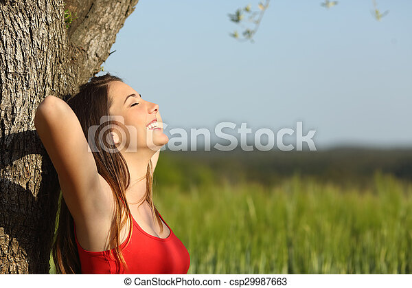 Woman resting and relaxed in a meadow