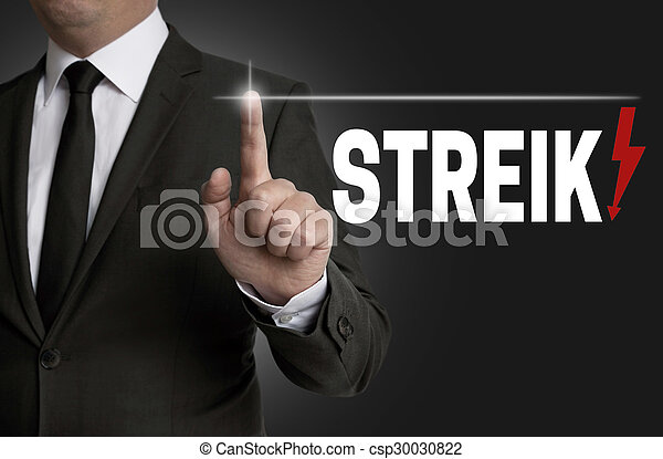 streik touchscreen is operated by businessman concept.