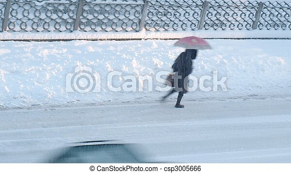 Girl walking in heavy snow - motion blur effect - (16:9 ratio) - csp3005666