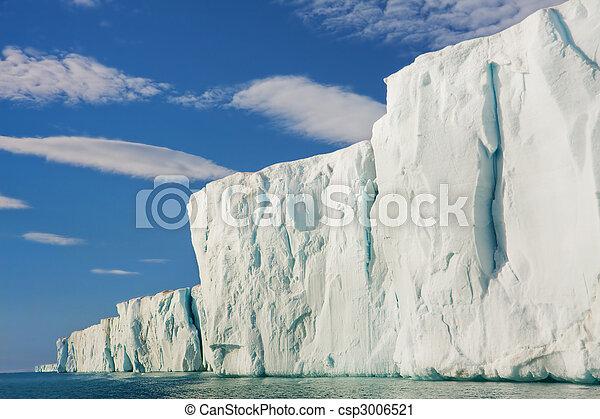 Sun Shining on Glacial Cliffside - csp3006521