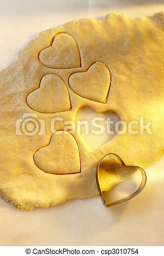 Heart shaped cookie cutter with dough - csp3010754