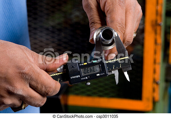 Hands Holding a Tool Measuring a Pipe - csp3011035