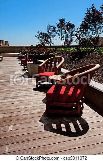 Wooden Patio Chairs on a Deck - csp3011072