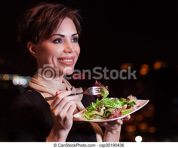 Happy woman eating salad - csp30190436