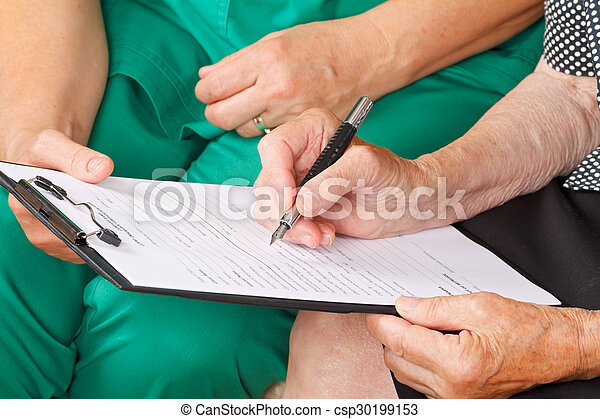 A senior woman\'s hand signing a document