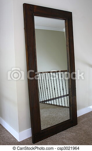 stock photo tall stand up mirror with wood frame