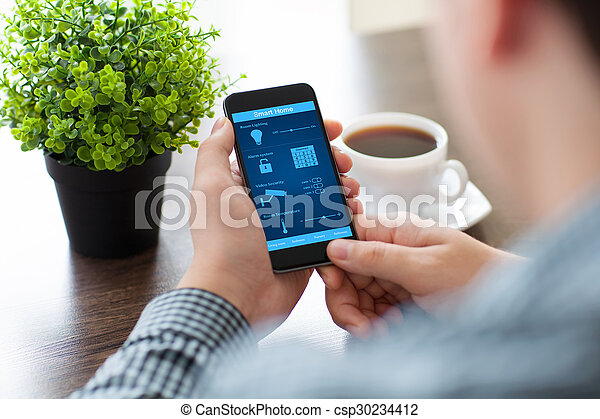 man holding the phone with program smart home on screen
