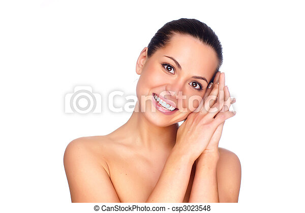 portrait of a young beautiful brunettes with perfect skin and a smile - csp3023548