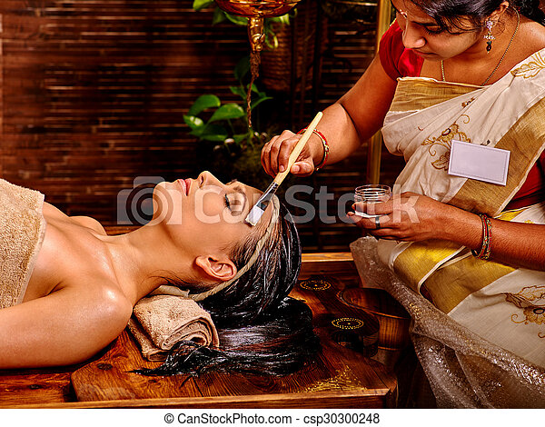 Woman having mask at ayurveda spa. - csp30300248