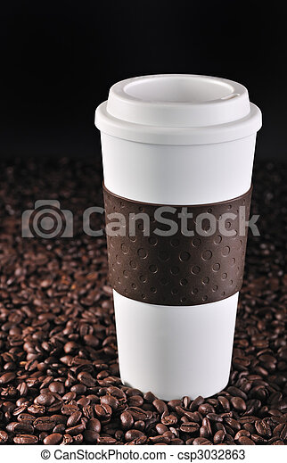 Commuter cup on coffee beans. - csp3032863