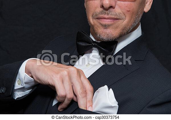 Gentleman In Black Tie Fixes Pocket Square, Horizontal
