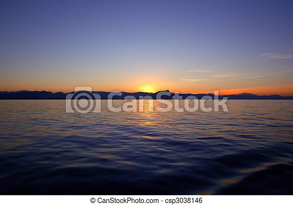 Beautiful sunset sunrise over blue sea ocean red  sky - csp3038146
