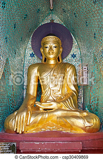 Buddha image at the Shwedagon Pagoda, a gilded stupa located in Yangon, Myanmar. The 99 metres tall pagoda is situated on Singuttare Hill, to the West of Kandawgyi Lake and dominates the Yangon skyline. It is the most sacred Buddhist pagoda in Myanmar.