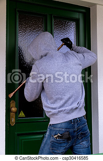 burglar at a house door - csp30416585