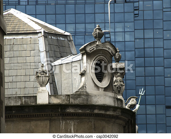 Window of an old building, classical architecture, in contrast with modern glass wall. London. - csp3042092