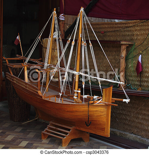 Photo - Model dhow and Qatari flag - stock image, images, royalty free ...