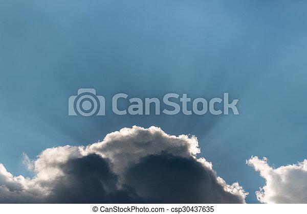 sun rays breaking through clouds - csp30437635