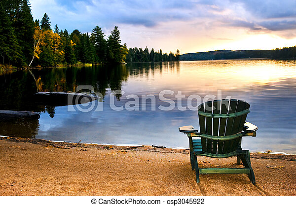 Wooden chair at sunset on beach - csp3045922