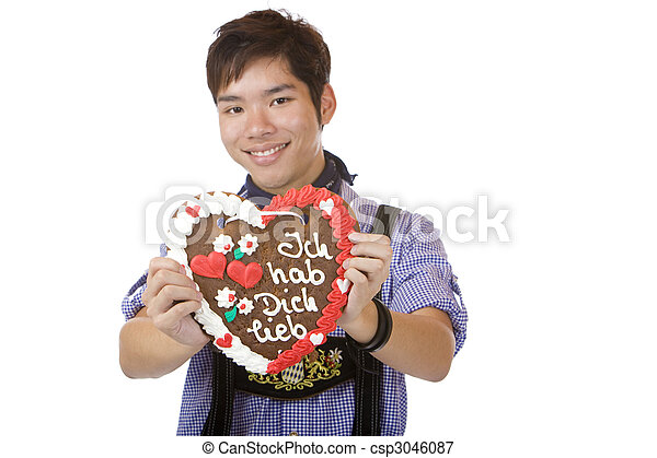 Asian holding Oktoberfest heart in camera and smiles  - csp3046087