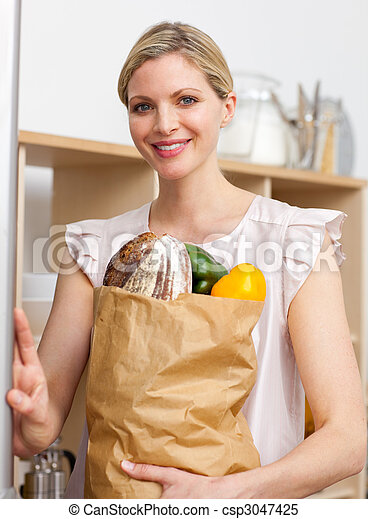 Attractive woman holding a grocery bag - csp3047425