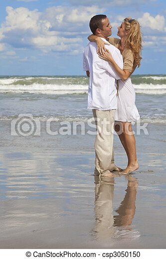 Man and Woman Couple Having In Romantic Embrace On Beach - csp3050150