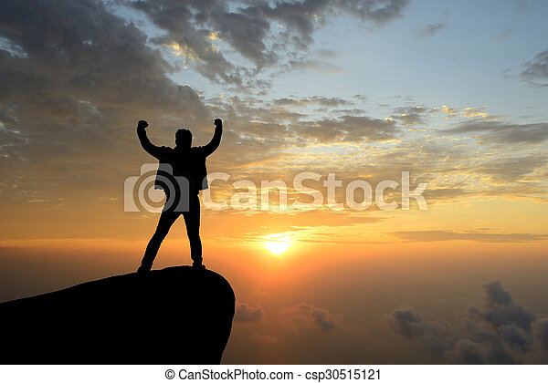 silhouette achievements successful man is on top of hill celebrating success with sunrise