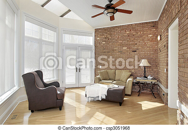 Sun room with brick wall - csp3051968
