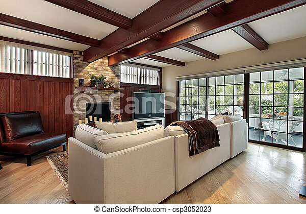 Family room with wood beams - csp3052023