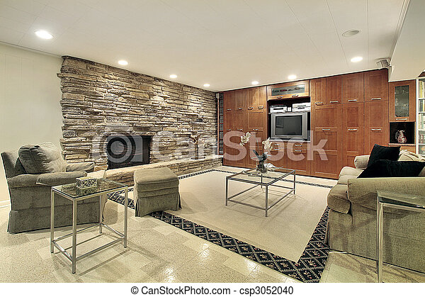 Lower level with stone fireplace - csp3052040