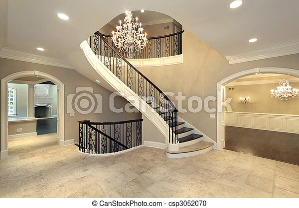 Foyer with curved stairway - csp3052070