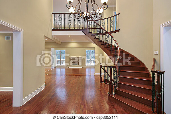 Foyer with balcony and curved staircase - csp3052111