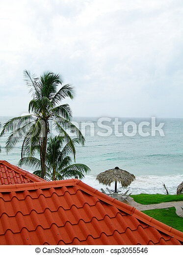 architectural detail of typical new modern roof construction of cabana and thatch roof shelter on corn island nicaragua with view of caribbean sea - csp3055546