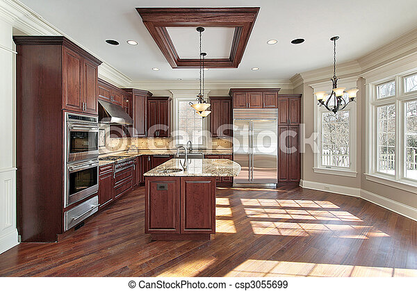 Kitchen and island in new construction home - csp3055699