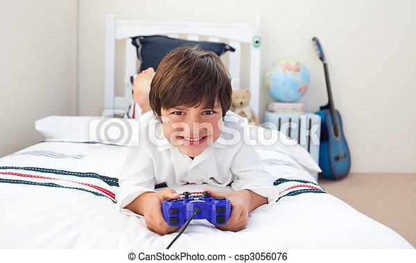 Cute little boy playing video games  - csp3056076