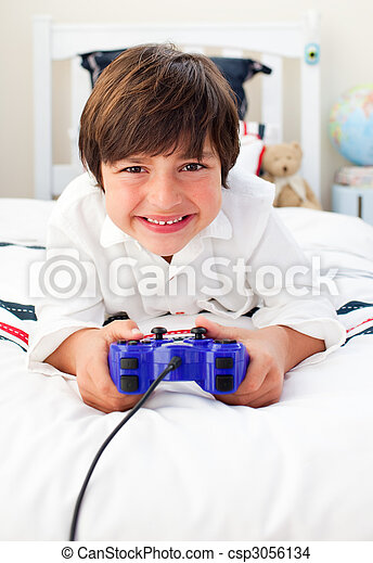 Happy boy playing video games  - csp3056134