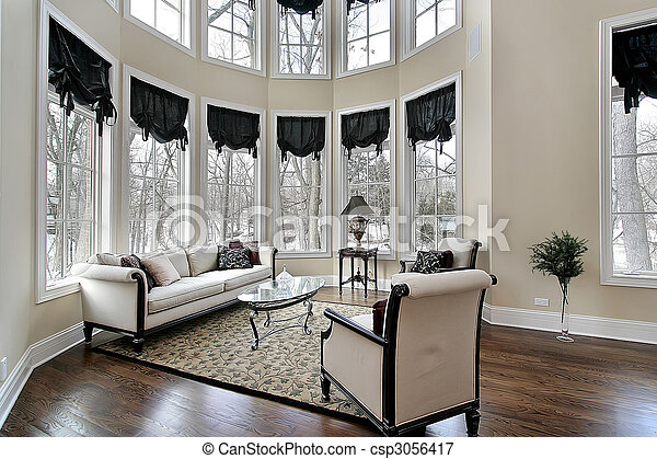 Living room with curved windows - csp3056417