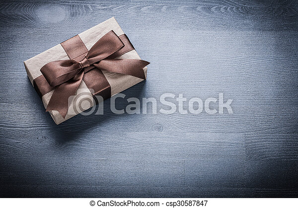 Packed present box on vintage wooden board holiday concept