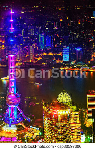 SHANGHAI,CHINA-MAY 24, 2015. Oriental Pearl Tower on blue sky background. Tower 470 meter the Oriental Pearl is one of Shanghai\'s tallest buildings, located at Lujiazui finance and trade zone in Pudong district in most dynamic city of China.
