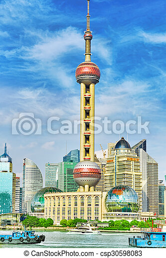 SHANGHAI-MAY 24, 2015. Oriental Pearl Tower on blue sky background. Tower 470 meter the Oriental Pearl is one of Shanghai\'s tallest buildings, located at Lujiazui finance and trade zone in Pudong district in most dynamic city of China.