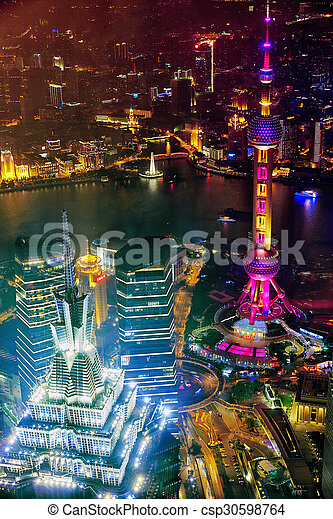 SHANGHAI-MAY 24, 2015. Oriental Pearl Tower at the nighttime. Tower 470 meter the Oriental Pearl is one of Shanghai\'s tallest buildings, located at Lujiazui finance and trade zone in Pudong district in most dynamic city of China.